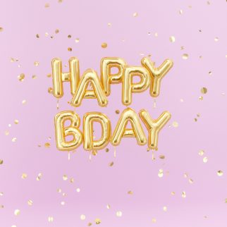 Happy Birthday text congratulations gold foil balloons and confetti on pink